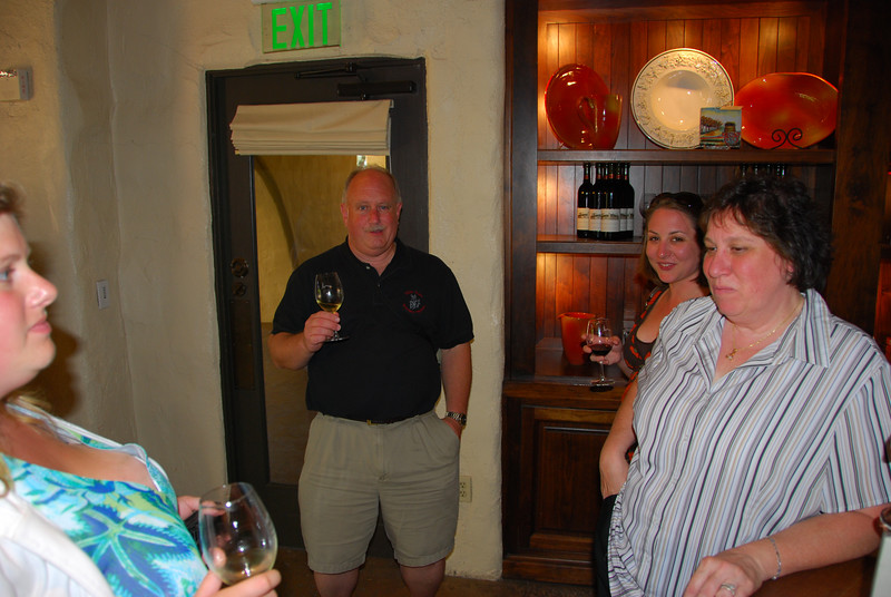 Part of Ginger's face, Ted, and Margo at Mondavi.