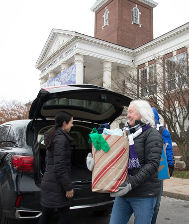 12/13/19 Wesley Bunnell | StaffrrToys, warm clothes, non perishable food items were collected on Friday from 6 a.m. until noon outside of CCSU's Davidson Hall in conjunction with CCSU and The Anna Grace Project's Love Wins. Katelyn Moore , L, donated boxes of children clothing which are taken away by CCSU Alumn Ryan Baldassario, not shown, and CCSU Professor Cheryl Crespi.