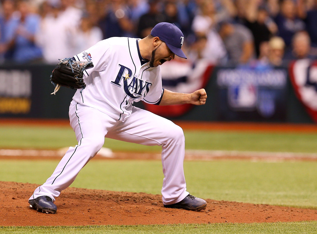 . Alex Torres #54 of the Tampa Bay Rays reacts after a strike out to end the sixth inning against the Boston Red Sox during Game Three of the American League Division Series at Tropicana Field on October 7, 2013 in St Petersburg, Florida.  (Photo by Mike Ehrmann/Getty Images)