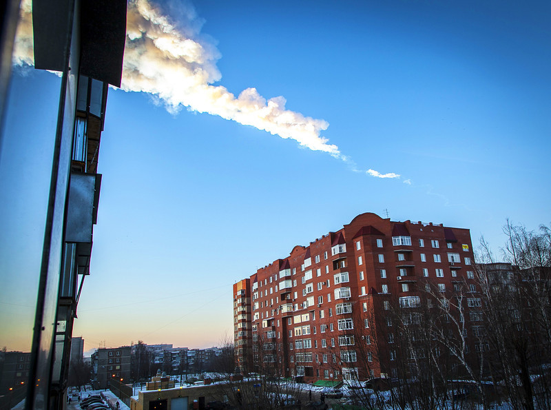 . A meteorite trail is seen above a residential apartment block in the Urals city of Chelyabinsk, on February 15, 2013. A heavy meteor shower rained down today on central Russia, sowing panic as the hurtling space debris smashed windows and injured dozens of stunned locals, officials said.  OLOVOLEG KARGOPOLOV/AFP/Getty Images