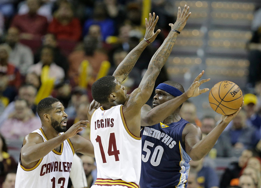 . Memphis Grizzlies\' Zach Randolph (50) looks to pass over Cleveland Cavaliers\' DeAndre Liggins (14) and Tristan Thompson (13) in the first half of an NBA basketball game Tuesday, Dec. 13, 2016, in Cleveland. (AP Photo/Tony Dejak)