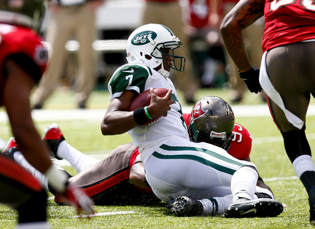 . Geno Smith #7 of the New York Jets scrambles against the Tampa Bay Buccaneers during their game at MetLife Stadium on September 8, 2013 in East Rutherford, New Jersey.  (Photo by Jeff Zelevansky/Getty Images)