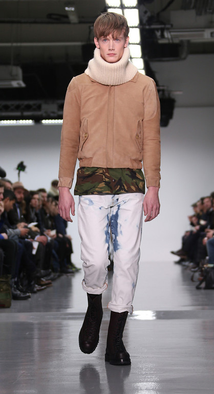 . A model wears a design created by Lou Dalton during London Collections for Men Autumn/Winter 2014, at Victoria House in Bloomsbury Square, central London, Monday, Jan. 6, 2014. (Joel Ryan/Invision/AP)