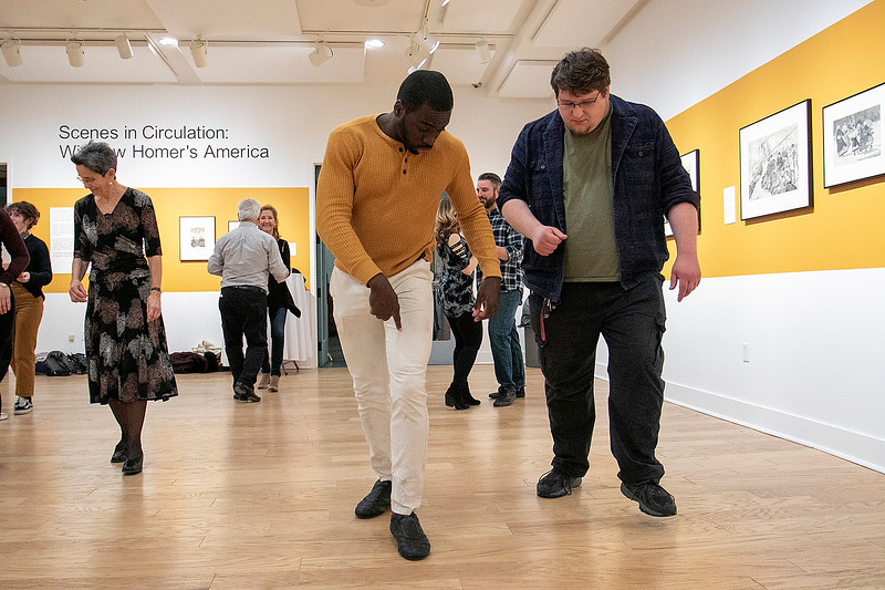 The first winter learn to dance salsa was held at the Fitchburg Art Museum on Friday night, Jan. 24, 2020. Lumyr Derisier, on left, from Boston helps Thomas Moser from Fitchburg with his step. SENTINEL & ENTERPRISE/JOHN LOVE
