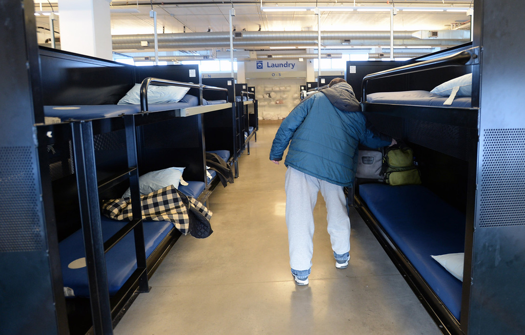 . A man places his belonging on a bunk at Higher Ground, a a seven-level homeless shelter and efficiency apartment building near the Minneapolis Farmers Market homeless shelter, on Monday, January 6, 2014.  (Pioneer Press: Chris Polydoroff)