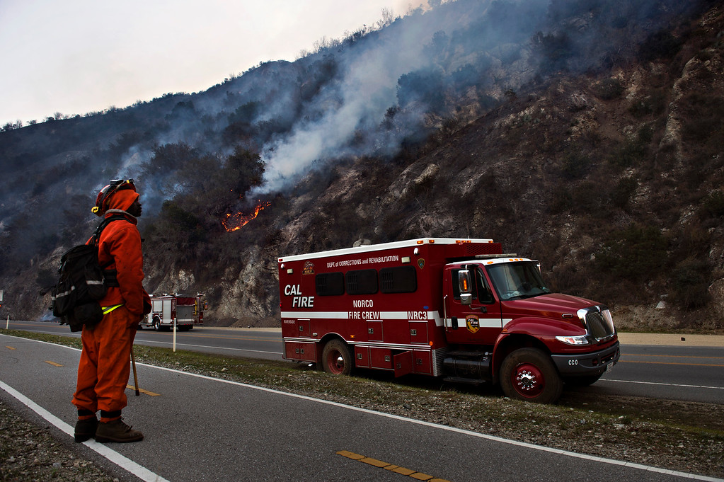. Fire crews keep a watch on hotspots along Highway 39 near the Mountain Cove community as the Colby Fire burns in Azusa on Friday morning, Jan. 17, 2014. (Photo by Watchara Phomicinda/ San Gabriel Valley Tribune)