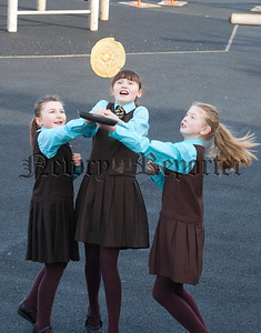 """As part of Fairtrade fortnight St Clares Primary School celebrated Pancake Tuesday """"Fair Trade Style"""". Pupils enjoyed hot chocolate from Grounded and Fairtrade pancake toppings from Sainsburys. Pictured are pupils Jenna O'Hanlon, Amy Finnegan and Dearbhla Grant. R1410015"""