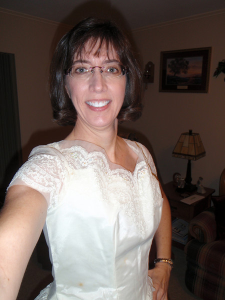 Trying on Sarah's wedding dress for fun (and not quite filling it out!)
