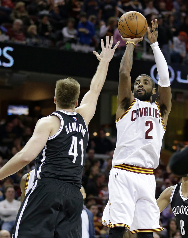 . Cleveland Cavaliers\' Kyrie Irving (2) shoots against Brooklyn Nets\' Justin Hamilton (41) during the second half of an NBA basketball game, Friday, Jan. 27, 2017, in Cleveland. (AP Photo/Tony Dejak)