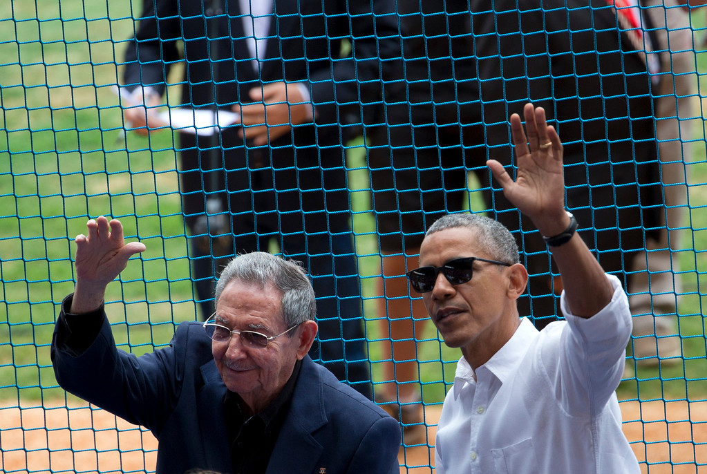 . U.S. President Barack Obama, right, and his Cuban counterpart Raul Castro wave to cheering fans as they arrive for a baseball game between the Tampa Bay Rays and the Cuban national baseball team, in Havana, Cuba, Tuesday, March 22, 2016. The crowd roared as Obama and Cuban President Raul Castro entered the stadium and walked toward their seats in the VIP section behind home plate. It\'s the first game featuring an MLB team in Cuba since the Baltimore Orioles played in the country in 1999. (AP Photo/Rebecca Blackwell)