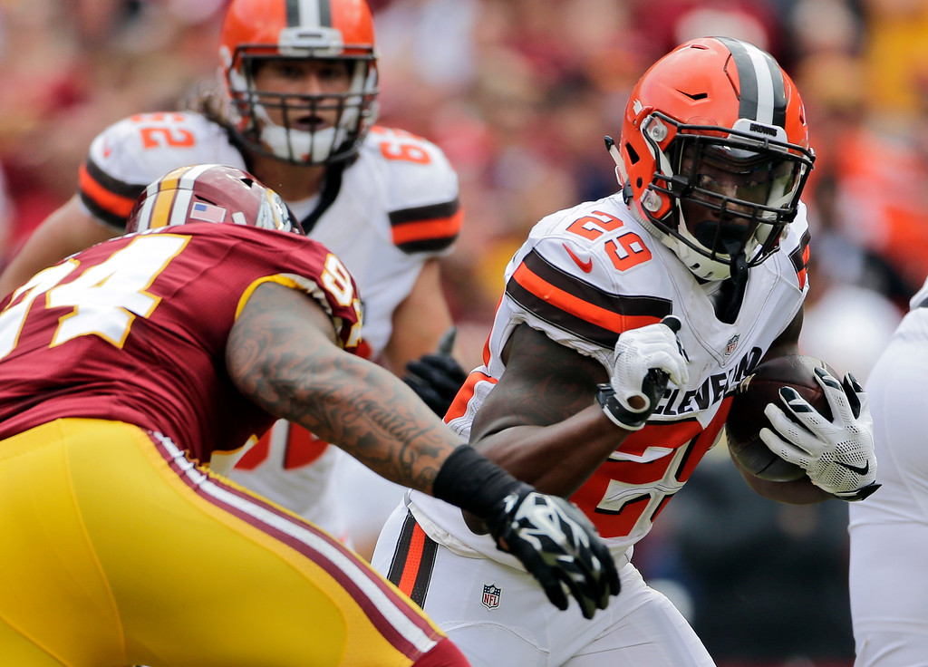. Cleveland Browns running back Duke Johnson (29) tries to get away from Washington Redskins outside linebacker Preston Smith (94) during the first half of an NFL football game Sunday, Oct. 2, 2016, in Landover, Md. (AP Photo/Mark Tenally)
