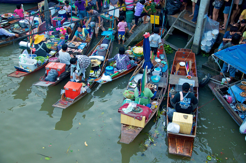 Shops on boats, shame they don't use the rubbish bin :(
