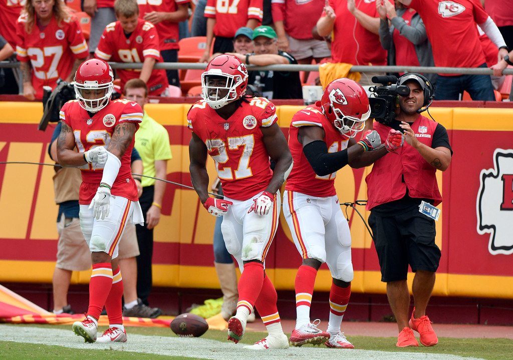 . Kansas City Chiefs running back Kareem Hunt (27) celebrates his 53 yard touchdown, during the second half of an NFL football game against the Philadelphia Eagles in Kansas City, Mo., Sunday, Sept. 17, 2017. (AP Photo/Ed Zurga)