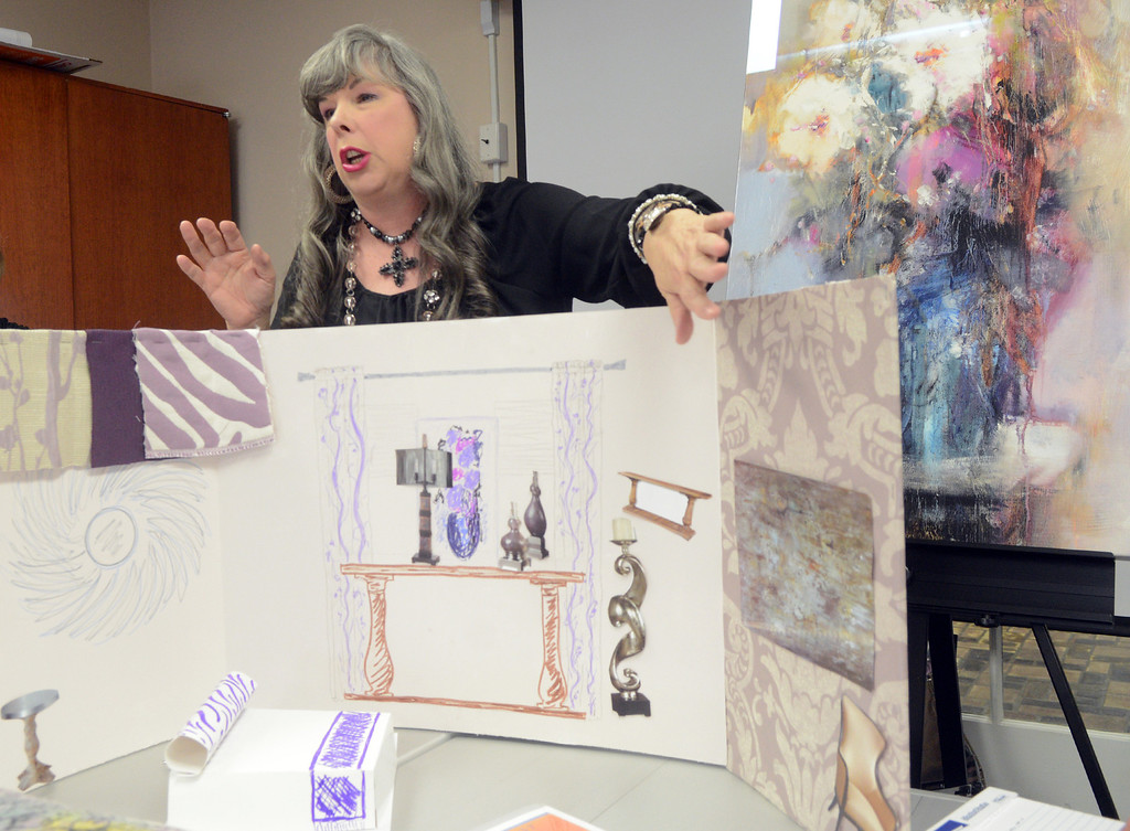 . Duncan Scott/DScott@News-Herald.com Betty Klammer presents her design ideas for a bedroom in the 2014 Lake County YMCA Dream House on April 7. This year\'s dream house is a brownstone located at The Residences at Willoughby Pointe in downtown Willoughby.