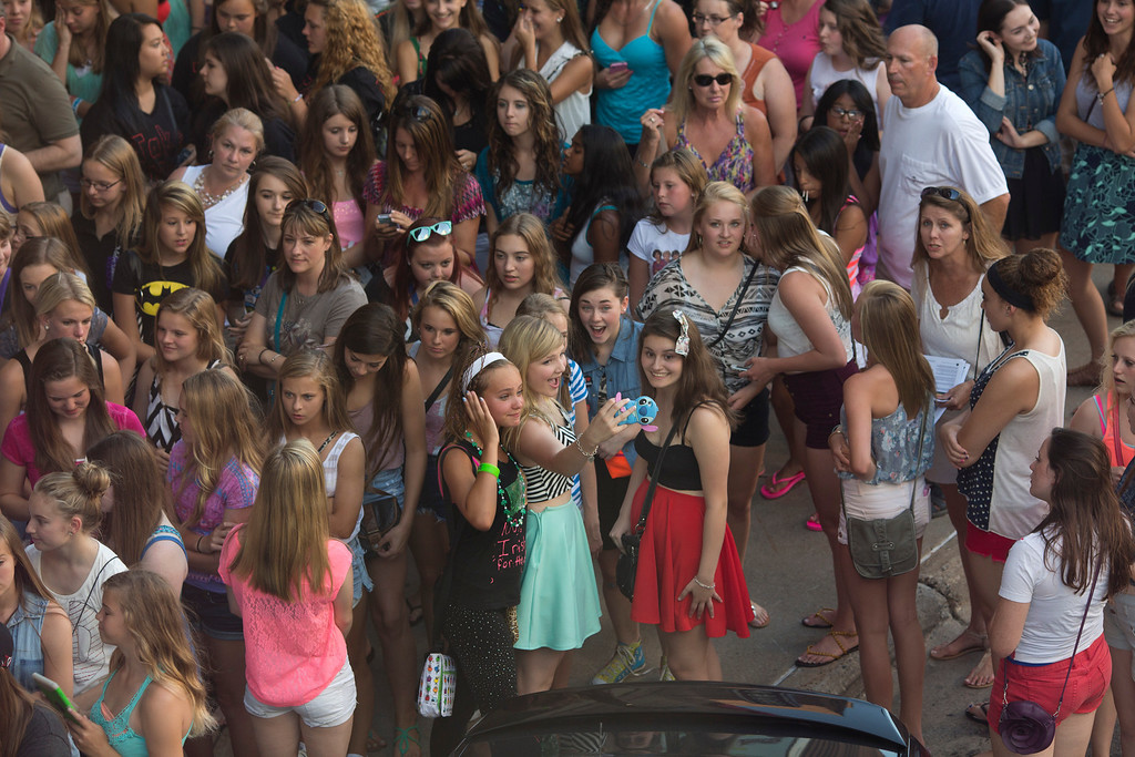 . British boy-band phenomenon One Direction performed at Target Center in Minneapolis Thursday night, July 18, 2013. The crowd of One Direction fans waited as the line slowly brought them closer to the entrance to Target Center Thursday night. (AP Photo/Star Tribune, Jeff Wheeler)