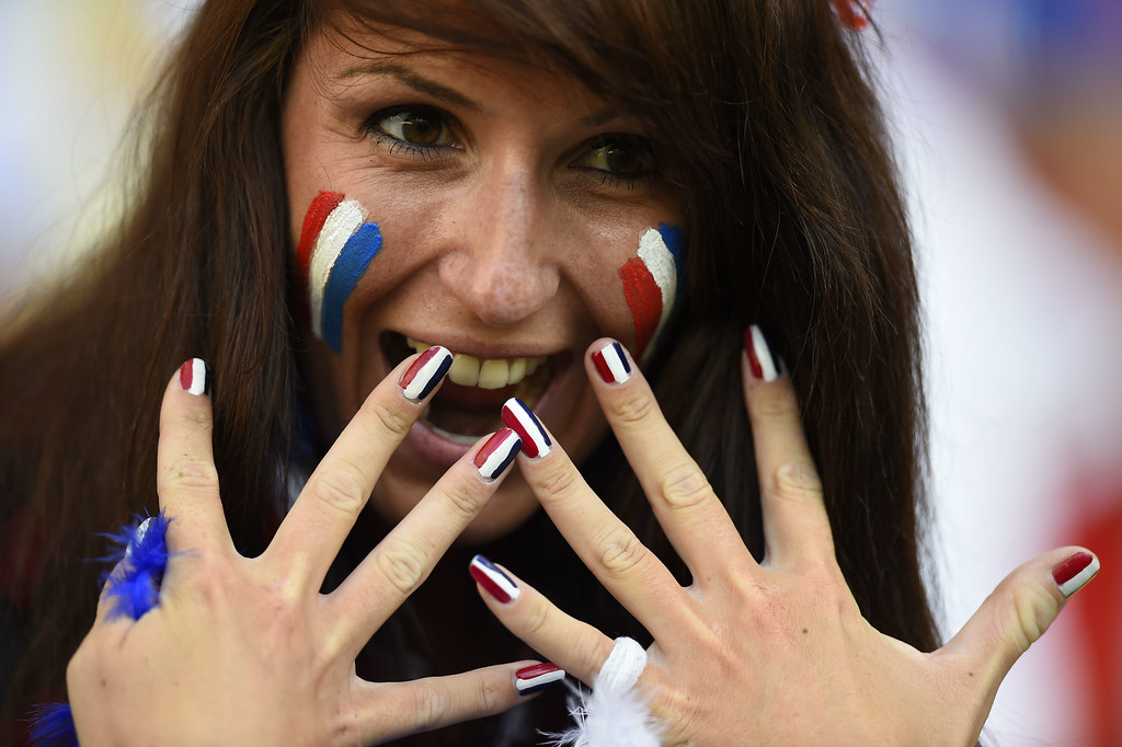 . A French supporter poses prior to the start of a Group E football match between Ecuador and France at the Maracana Stadium in Rio de Janeiro during the 2014 FIFA World Cup on June 25, 2014. ODD ANDERSEN/AFP/Getty Images
