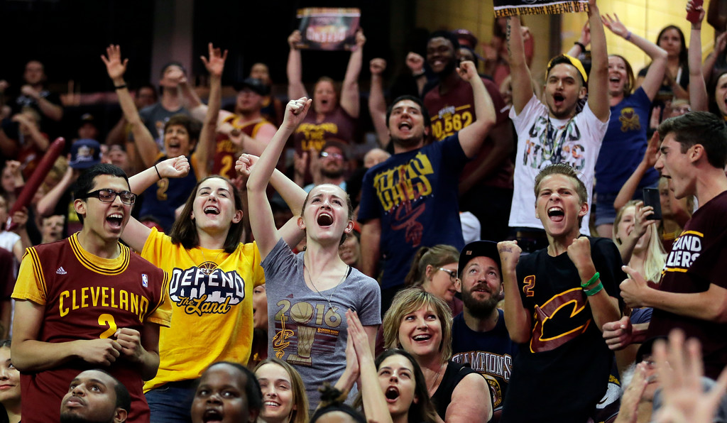 . Cleveland Cavaliers fans cheer during a watch party at Quicken Loans Arena during Game 5 of basketball\'s NBA Finals between the Golden State Warriors and the Cleveland Cavaliers, Monday, June 12, 2017, in Cleveland. (AP Photo/Tony Dejak)