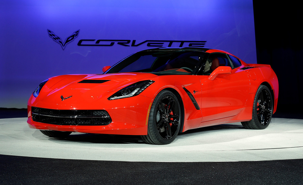 . The 2014 Chevrolet Corvette Stingray is revealed at media previews for the North American International Auto Show in Detroit, Monday, Jan. 14, 2013.  (AP Photo/Paul Sancya)