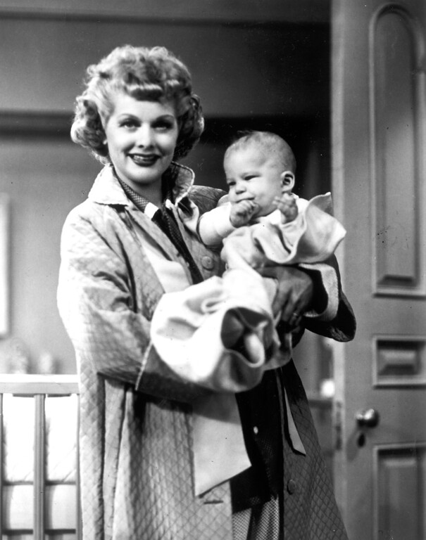 . Lucille Ball poses with Richard Lee Simmons, one of the twins who portrayed son Little Ricky during the spring of 1953.   Los Angeles Daily News file photo