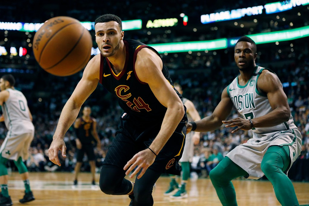 . The ball goes out-of-bounds in front of Cleveland Cavaliers\' Larry Nance Jr. (24) and Boston Celtics\' Semi Ojeleye (37) during the fourth quarter of an NBA basketball game in Boston, Sunday, Feb. 11, 2018. (AP Photo/Michael Dwyer)