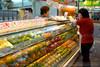 Women at fruit store