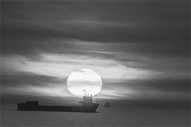 Cargo Ship and Setting Sun in North Sea