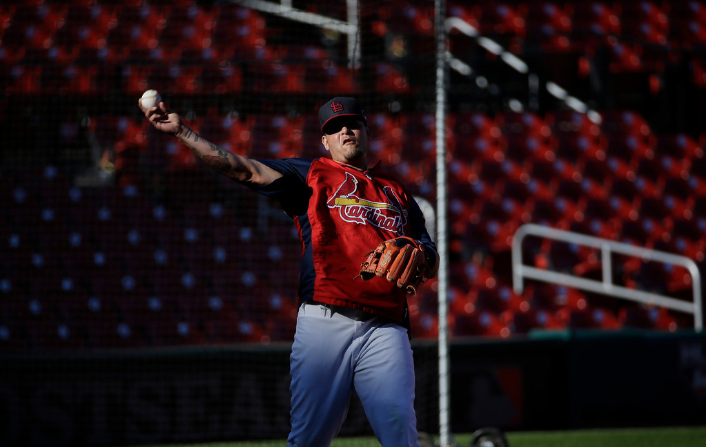 . St. Louis Cardinals catcher Yadier Molina throws before Game 1 of the National League baseball championship series against the Los Angeles Dodgers Friday, Oct. 11, 2013, in St. Louis. (AP Photo/David J. Phillip)
