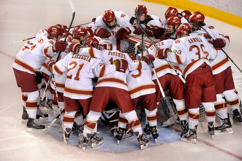 . The Denver Pioneers gathered around starting goalie Juho Olkinuora before the game Saturday. The University of Denver hockey team hosted Cornell at Magness Arena Saturday night, January 5, 2013. Karl Gehring/The Denver Post