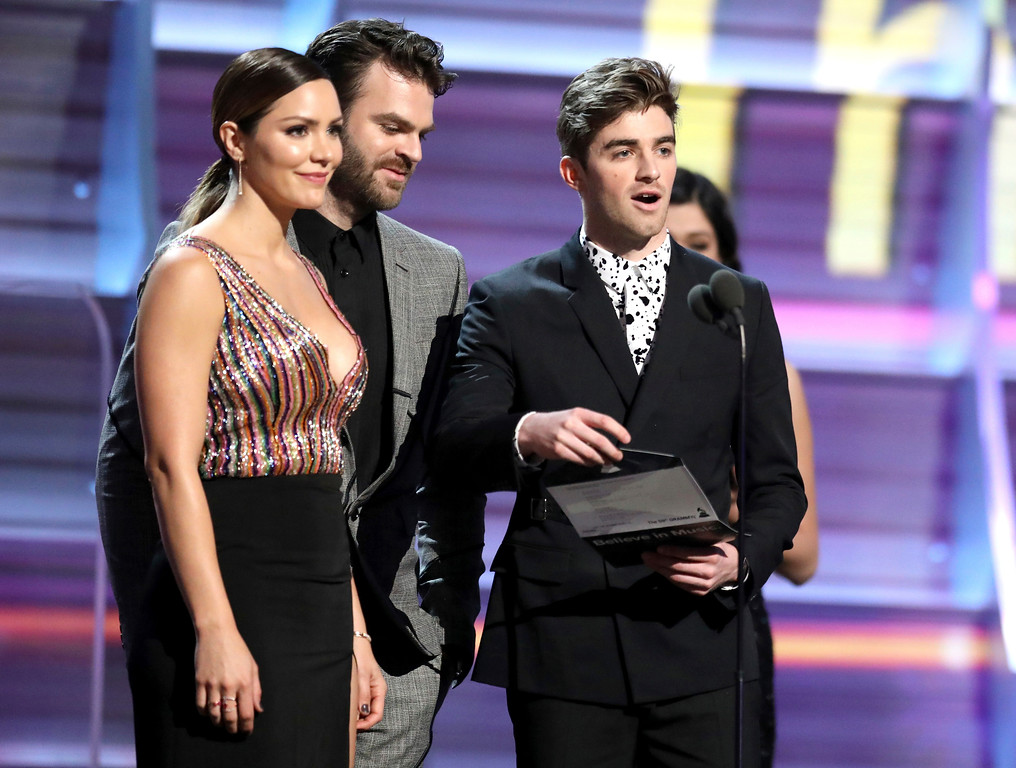 ". Katharine McPhee, from left, Alex Pall and Andrew Taggart of ""The Chainsmokers\"" present the award for best rock song at the 59th annual Grammy Awards on Sunday, Feb. 12, 2017, in Los Angeles. (Photo by Matt Sayles/Invision/AP)"
