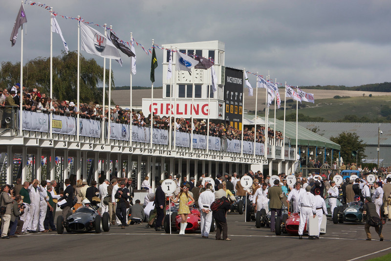 Goodwood 2011, cars on the starting grid, grid girls, with more rain approaching