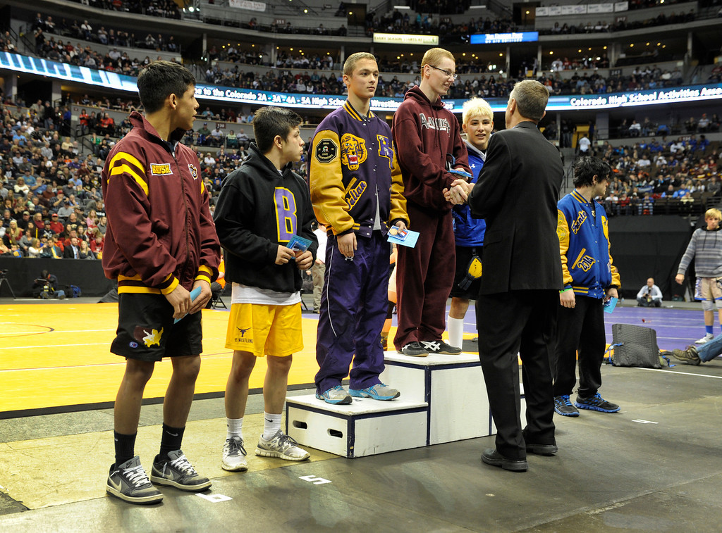 . DENVER, CO. - FEBRUARY 23: The top six wrestlers in class 3A, 120-pound weight division were given their medals during an awards presentation ceremony Saturday night. Alamosa High School senior Neff Malouff took the title. The CHSAA State Wrestling Tournament wrapped up, February 23, 2013, with final matches following the Parade of Champions at the Pepsi Center in downtown Denver. (Photo By Karl Gehring/The Denver Post)