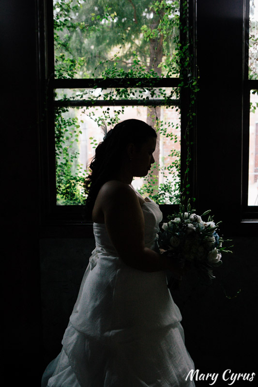 Bride in silhouette at the McKinney Cotton Mill | Photo by Mary Cyrus Photography - Weddings & Portraits in Dallas & Beyond