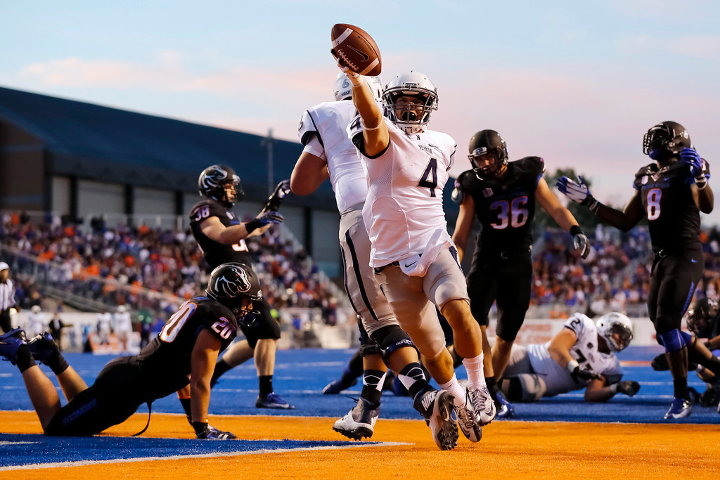 . Nevada running back Kendall Brock (4) scores a touchdown during the first half of an NCAA college football game against Boise State in Boise, Idaho, Saturday, Oct. 19, 2013. (AP Photo/Otto Kitsinger)