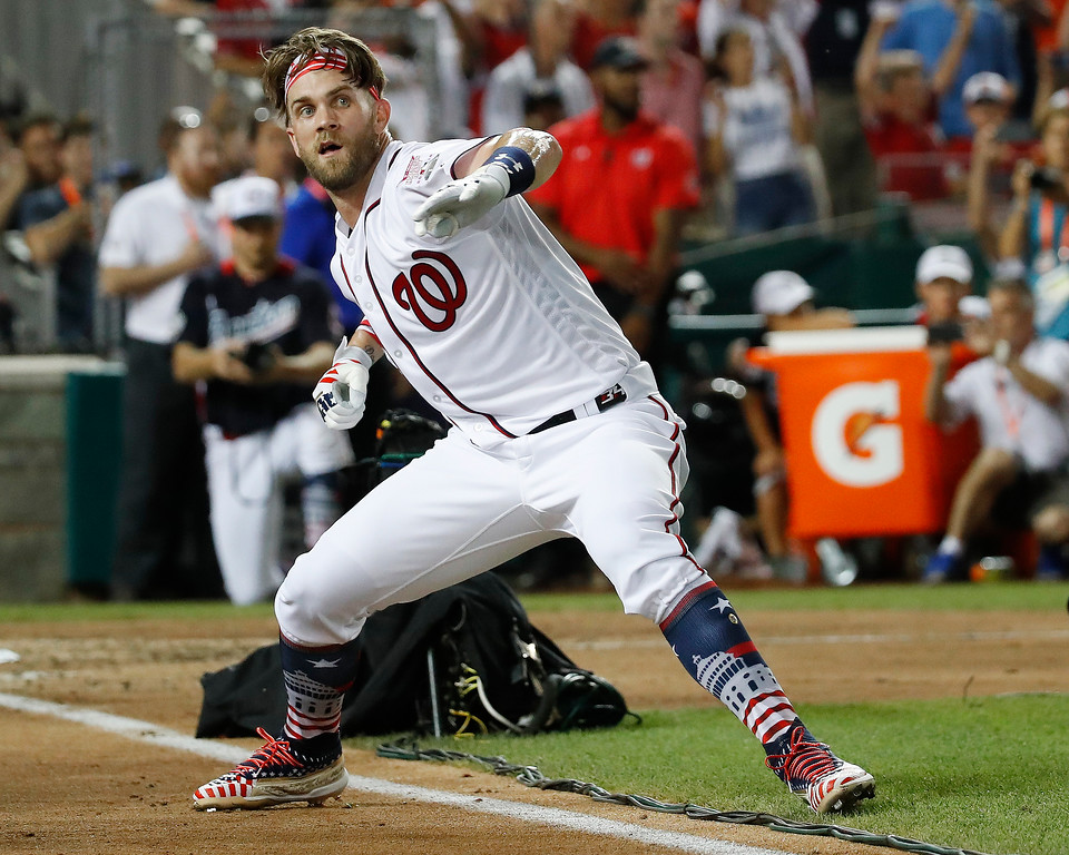 . Washington Nationals Bryce Harper celebrates his winning hit during the Major League Baseball Home Run Derby, Monday, July 16, 2018 in Washington. (AP Photo/Alex Brandon)
