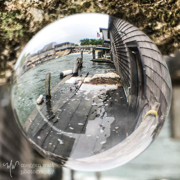 TLR-20190624-0715 Fishtown through glass sphere, water level high