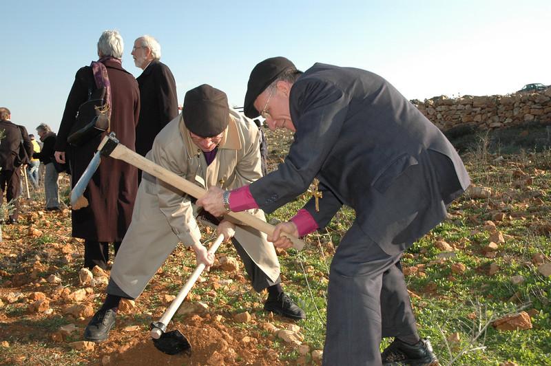 Bishop Richard Graham, left, ELCA Metropolitan Washington, D.C. Synod, and ELCJHL Bishop Munib Younan, plant an olive tree at Beddo, West Bank, Jan. 12.