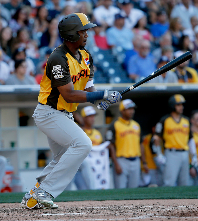 . World Team\'s Eloy Jimenez, of the Chicago Cubs, hits against the U.S. Team during the seventh inning of the All-Star Futures baseball game, Sunday, July 10, 2016, in San Diego. (AP Photo/Lenny Ignelzi)