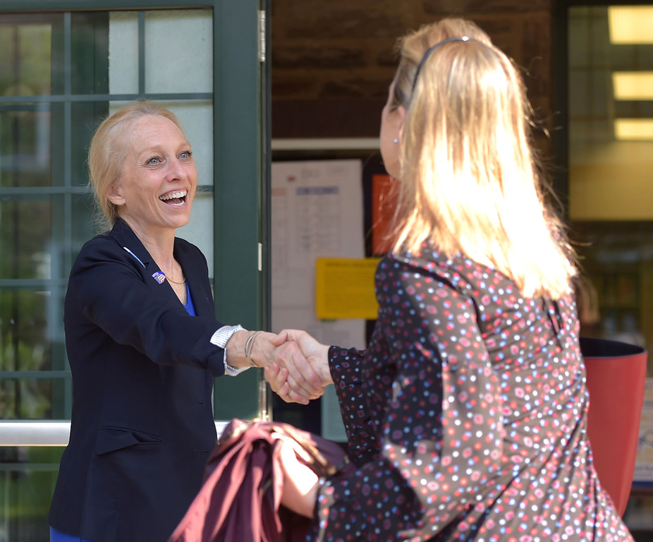 . PETE  BANNAN-DIGITAL FIRST MEDIA       Mary Gay Scanlon greets Kaitlin Gurney outside the Furness Library in Wallingford Tuesday morning.