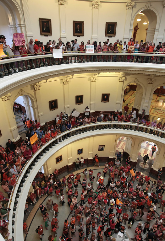 . Pro-choice and pro-life supporters fill the Texas State capitol rotunda on July 1, 2013 in Austin, Texas. This is the first day of a second legislative special session called by Texas Gov. Rick Perry to pass a restrictive abortion law through the Texas legislature. The first attempt was defeated after opponents of the law were able to stall the vote until after first special session had ended.  (Photo by Erich Schlegel/Getty Images)