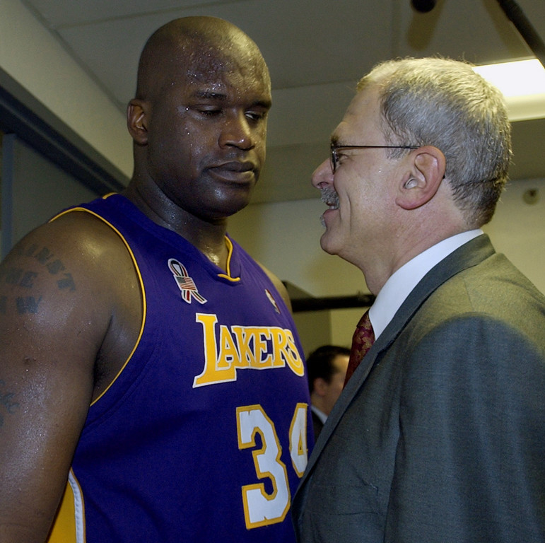 . Los Angeles Lakers head coach Phil Jackson, right, congratulates Shaquille O\'Neal in the locker room after they beat the Sacramento Kings 112-106 in overtime in Game 7 of the Western Conference finals in Sacramento, Calif., Sunday, June 2, 2002. (AP Photo/Mark J. Terrill)