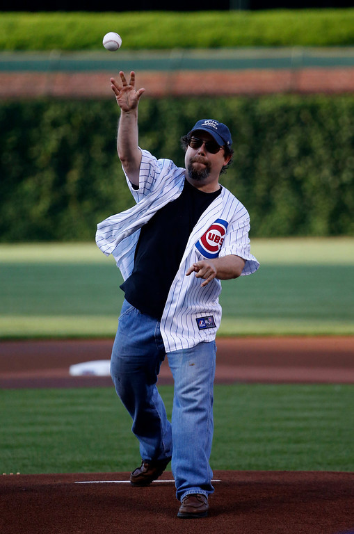 . Brian Posen throws out a ceremonial first pitch before an interleague  baseball game between the Chicago Cubs and the Los Angeles Angels Wednesday, July 10, 2013, in Chicago. (AP Photo/Charles Rex Arbogast)