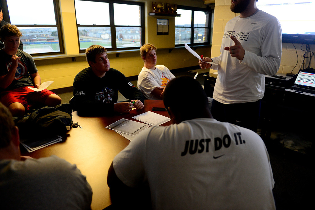 . Valor Christian starting left guard Ryan Cummings (black shirt) and left tackle Alec Ruth (sitting to Cummings\' left) listen during an offensive line meeting. (Photo by AAron Ontiveroz/The Denver Post)