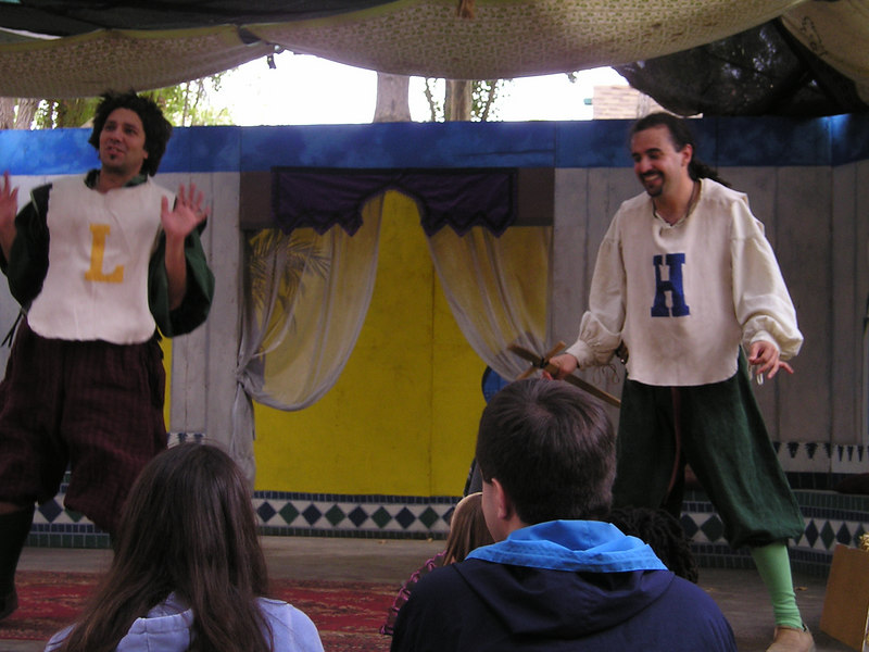 Renaissance Pleasure Faire, Hollister 2006: Marlowe's Shadow does 5 Shakespeare plays in 20 minutes: Hamlet and Laertes (you can tell by the letters on their chests)