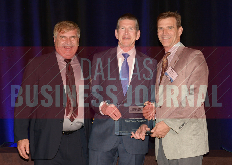 Arlington Commons was presented the best Suburban Multifamily award from Bret Robertson, center, of presenting sponsor CF Accountants & Consultants.