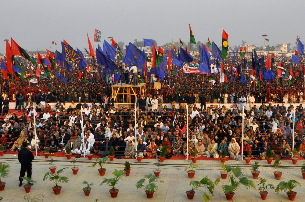 Description of . Pakistan Peoples Party (PPP) supporters gather to listen to the speech of Bilawal Bhutto Zardari, son of assassinated former Pakistani prime minister Benazir Bhutto, to launch his political career during the fifth anniversary of his mother's death, at the Bhutto family mausoleum in Garhi Khuda Bakhsh, near Larkana December 27, 2012. Benazir Bhutto was killed in a gun and suicide bomb attack after an election rally in the city of Rawalpindi on December 27, 2007, weeks after she returned to Pakistan after years in self-imposed exile. REUTERS/Nadeem Soomro