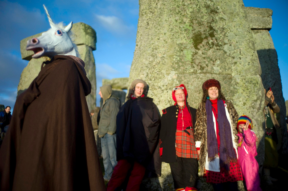 Description of . A reveller dressed as a unicorn celebrates the sunrise during the winter solstice at Stonehenge on Salisbury plain in southern England December 21, 2012. The winter solstice is the shortest day of the year, and the longest night of the year. REUTERS/Kieran Doherty