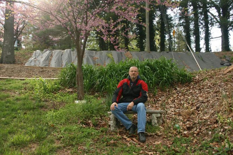 Gary sits on bench at memorial gardens - Asheville, North Carolina