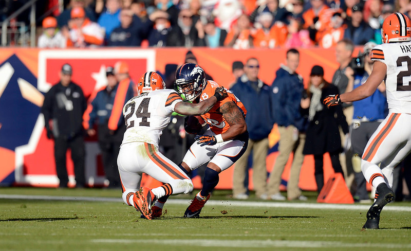 . Denver Broncos wide receiver Demaryius Thomas (88) makes a first down catch during the first half.  The Denver Broncos vs Cleveland Browns at Sports Authority Field Sunday December 23, 2012. Joe Amon, The Denver Post