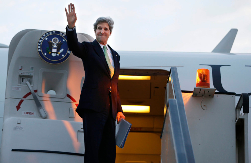 . U.S. Secretary of State John Kerry waves goodbye as he leaves Cairo, Egypt en route to Riyadh, Saudi Arabia on Sunday, March 3, 2013. Kerry met with Egypt\'s president Sunday, wrapping up a visit to the deeply divided country with an appeal for unity and reform. The U.S. is deeply concerned that continued instability in Egypt will have broader consequences in a region already rocked by unrest. (AP Photo/Jacquelyn Martin, Pool)