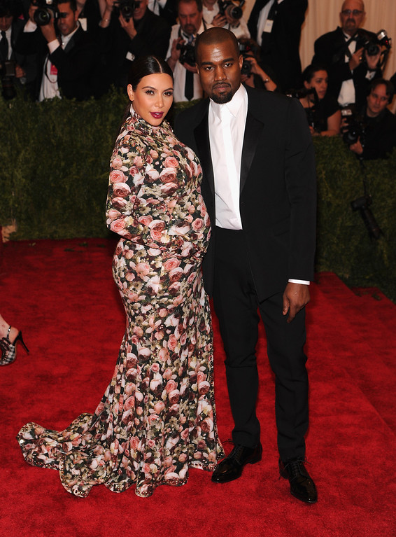 ". NEW YORK, NY - MAY 06:  Kim Kardashian and  Kanye West attend the Costume Institute Gala for the ""PUNK: Chaos to Couture\"" exhibition at the Metropolitan Museum of Art on May 6, 2013 in New York City.  (Photo by Jamie McCarthy/Getty Images for The Huffington Post)"